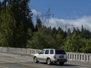 Power transmission lines and towers that run east through Vancouver are pictured above Burnt Bridge Creek on Monday morning. A balloon hit one of the lines near this spot on Aug. 21 and caused a brief power outage for nearly 19,000 people.