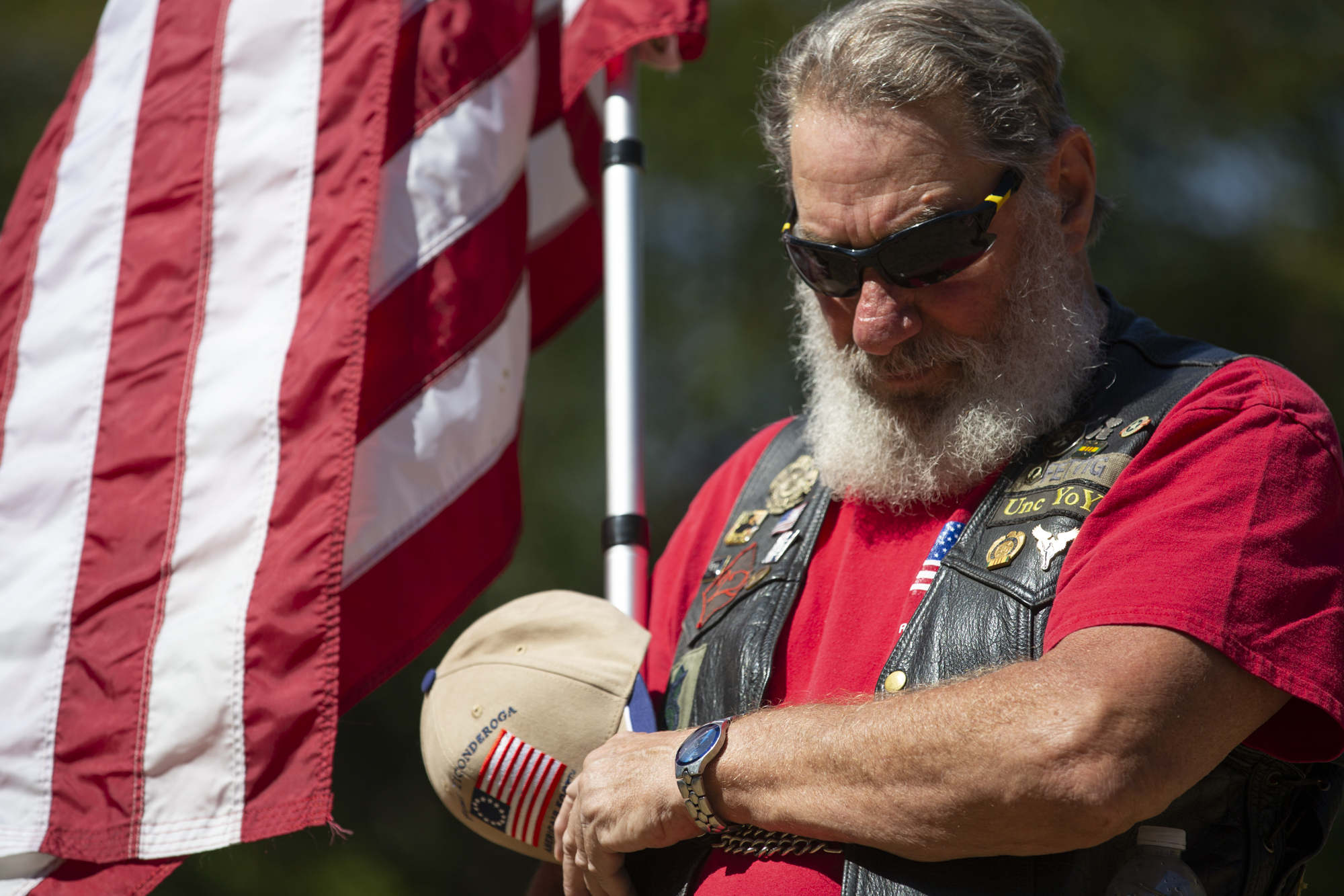 Patriot Guard Rider, Joe Fettig, also known as Unc YoYo, holds an American flag during a ceremony honoring the memory of U.S. Army Sgt. Earl D. Warner and U.S. Army Sgt. Bryce D. Howard at Fort Vancouver Barracks War Memorial in Vancouver on Saturday, August 28, 2021.