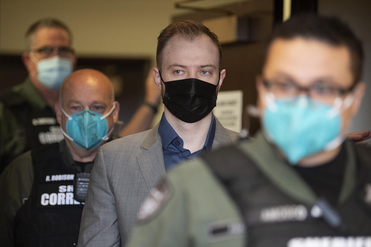 David Bogdanov is escorted into the courtroom on Friday before the verdict is read in the slaying of Nikki Kuhnhausen.