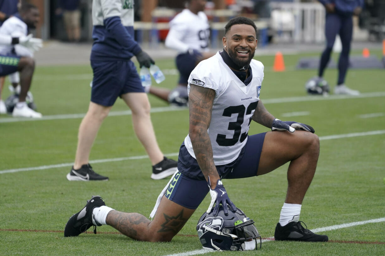 Seattle Seahawks safety Jamal Adams stretches before practice Tuesday, Aug. 17, 2021, in Renton. The Seahawks signed Adams to a four-year contract extension Tuesday that is expected to make the former All-Pro the highest-paid safety in the NFL. (AP Photo/Ted S.