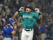 Seattle Mariners' Jarred Kelenic reacts to drawing a bases-loaded walk in the ninth inning to drive in the winning run in a baseball game against the Toronto Blue Jays on Friday, Aug. 13, 2021, in Seattle. The Mariners won 3-2.