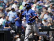 Toronto Blue Jays' Teoscar Hernandez points skyward after hitting a solo home run off a pitch by Seattle Mariners starter Logan Gilbert in the second inning on Sunday.