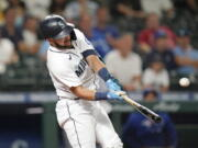Seattle Mariners' Luis Torrens doubles in a pair of runs against the Toronto Blue Jays during the eighth inning of a baseball game Saturday, Aug. 14, 2021, in Seattle.