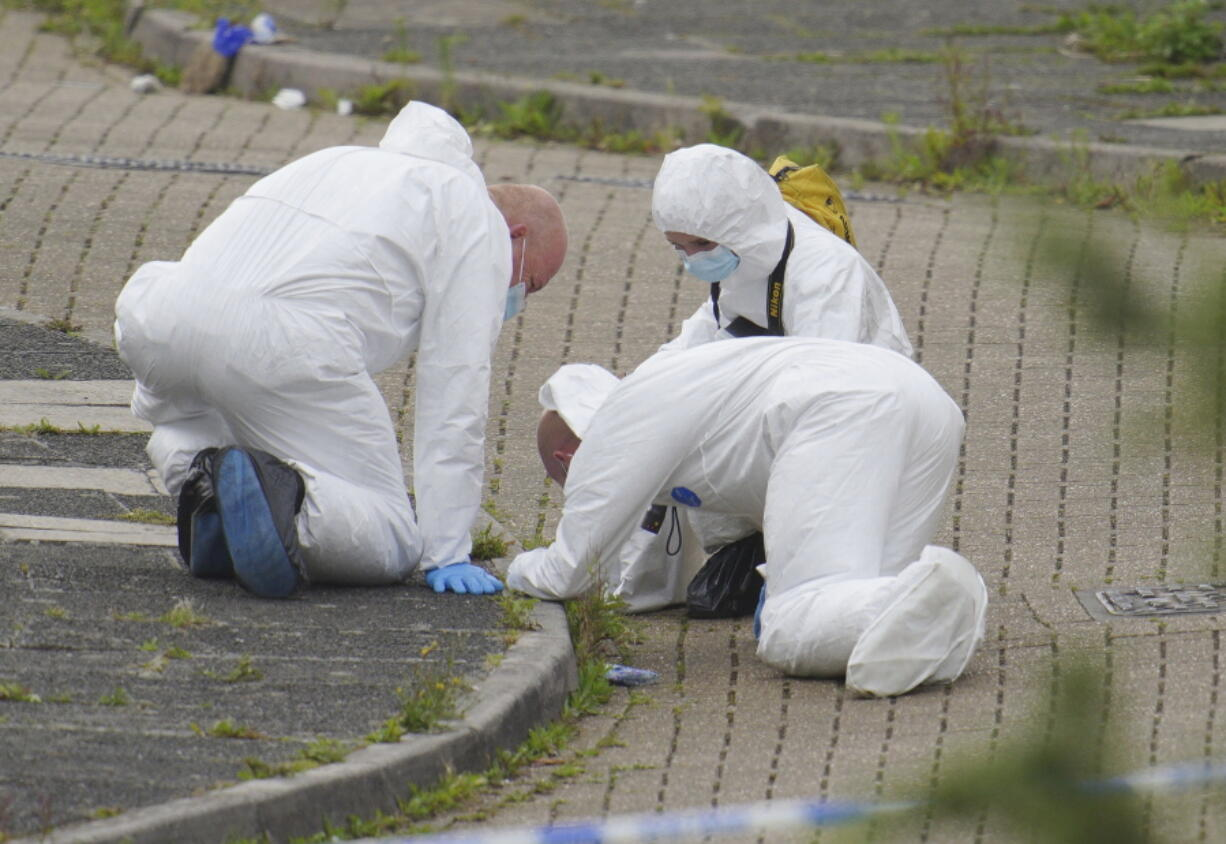 """Forensic officers work in Biddick Drive in the Keyham area of Plymouth, England Friday Aug. 13, 2021 where six people were killed in a shooting incident. Police in southwest England say several people were killed, including the suspected shooter, in the city of Plymouth in a """"serious firearms incident"""" that wasn't terror-related."""