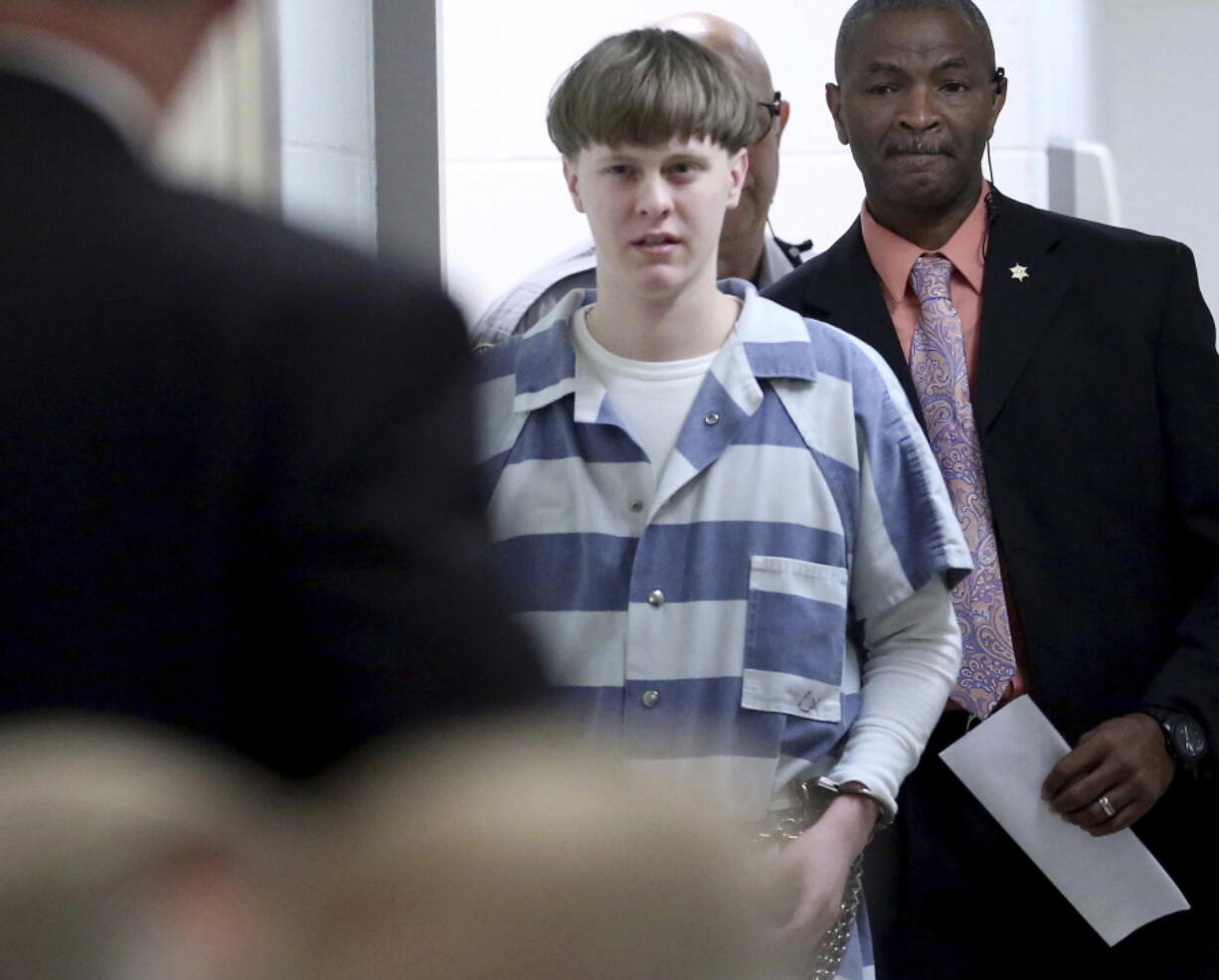 FILE - In this April 10, 2017, file photo, Dylann Roof enters the court room at the Charleston County Judicial Center to enter his guilty plea on murder charges in Charleston, S.C. A federal appeals court on Wednesday, Aug. 25, 2021, upheld Roof's conviction and sentence on federal death row for the 2015 racist slayings of nine members of a Black South Carolina congregation. A three-judge panel of the 4th U.S. Circuit Court of Appeals in Richmond affirmed Roof's conviction and sentence in the shootings at Mother Emanuel AME Church in Charleston.