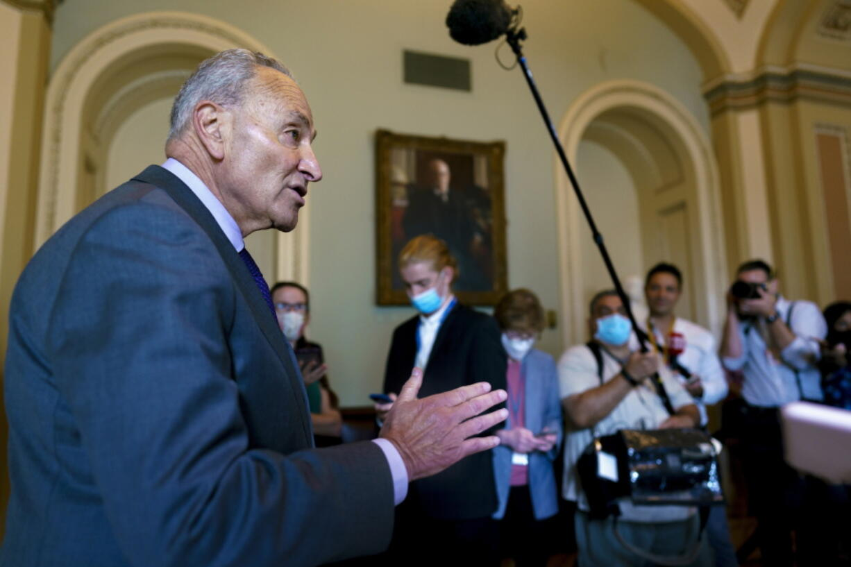 Senate Majority Leader Chuck Schumer, D-N.Y., updates reporters on the infrastructure negotiations between Republicans and Democrats, at the Capitol in Washington, Wednesday, July 28, 2021. (AP Photo/J.
