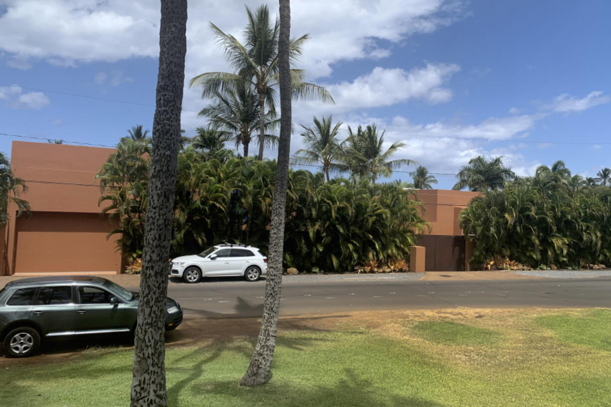 Part of a Maui mansion is seen from a street in Kihei, Hawaii on Thursday, Aug. 5, 2021. The $45-million cash sale of the eight-bedroom house reflects a hot real estate market where the median price of a Maui home topped $1.1 million in June. (J.D.