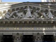FILE - This June 16, 2021 file photo shows the facade of the New York Stock Exchange.  Stocks are off to a mixed start on Wall Street, Tuesday, Aug. 3,  as traders weigh another big set of company earnings reports, which have been coming in largely ahead of analysts' forecasts.