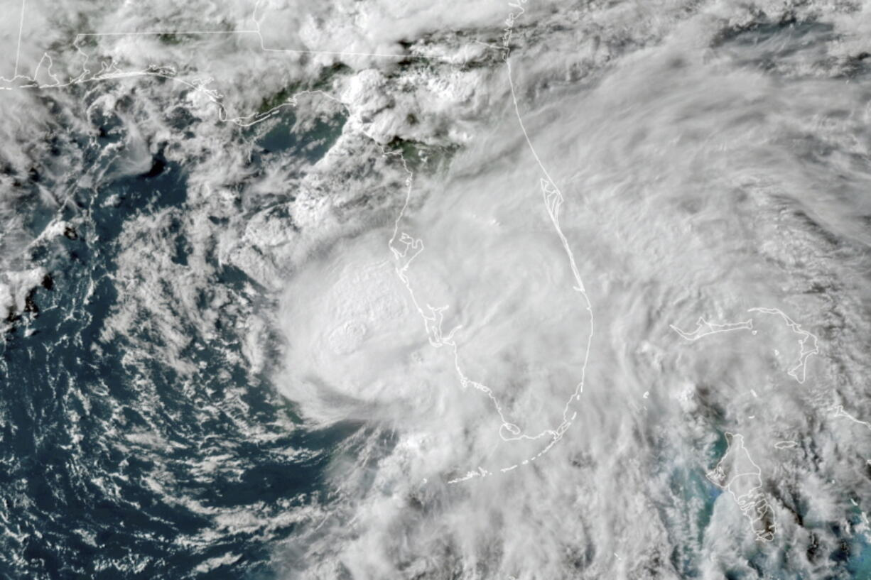 Tropical Storm Elsa in the Gulf of Mexico is seen July 6 off the coast of Florida. On Wednesday, the National Oceanic and Atmospheric Administration updated its outlook for the 2021 Atlantic season, slightly increasing the number of named storms and hurricanes expected in what is predicted to be a busy, but not record-breaking year.
