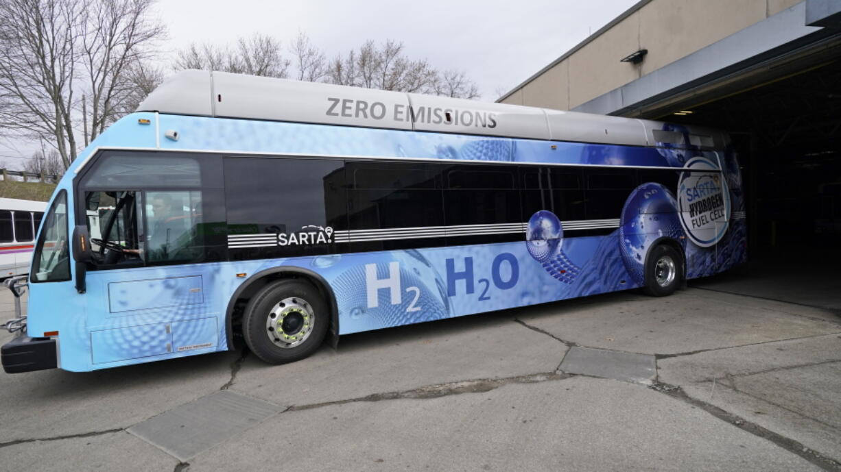 Kevin Baker, a maintenance technician, drives a hydrogen fuel cell bus out of the terminal, Tuesday, March 16, 2021, in Canton, Ohio. Hydrogen, the most abundant element in the universe, is increasingly viewed as a vital answer to troubling questions about how to slow the catastrophic effects of climate change attributed to the planet's 1.2 billion cars and trucks, nearly all of which burn gasoline and diesel.