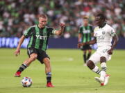 Austin FC midfielder Alex Ring protects the ball from Portland Timbers forward Dairon Asprilla during an MLS soccer match Saturday, Aug. 21, 2021, in Austin, Texas. (Aaron E.
