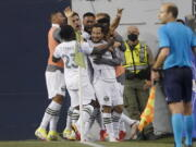 Portland Timbers midfielder Sebastian Blanco, center, celebrates with teammates after he scored a goal against the Seattle Sounders during the second half of an MLS soccer match, Sunday, Aug. 29, 2021, in Seattle. (AP Photo/Ted S.