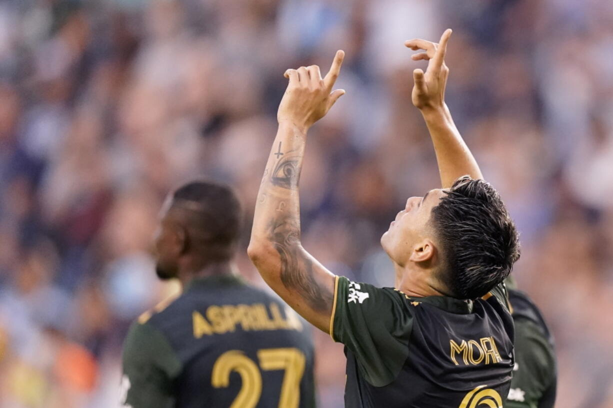 Portland Timbers forward Felipe Mora (9) celebrates after scoring a goal during the first half of an MLS soccer match against Sporting Kansas City Wednesday, Aug. 18, 2021, in Kansas City, Kan.