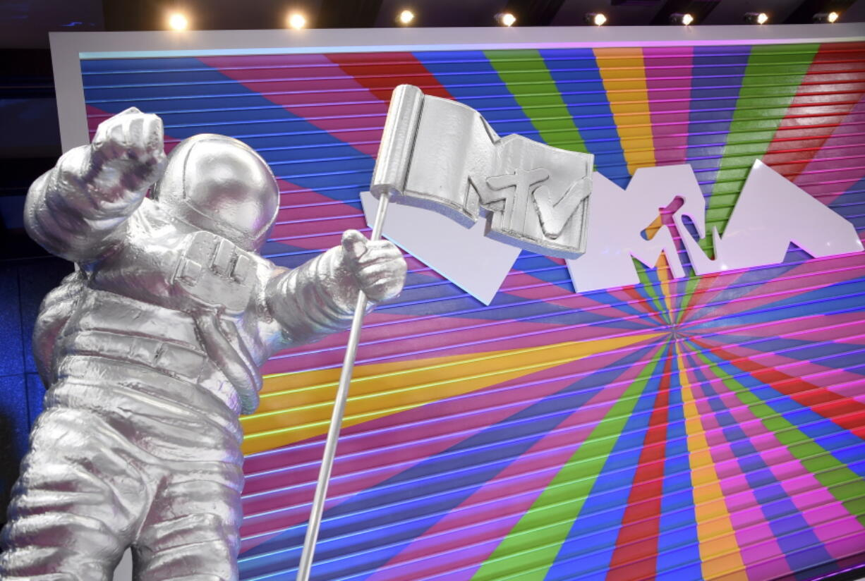 """In this Aug. 20, 2018, file photo, an MTV statue appears on the red carpet at the MTV Video Music Awards at Radio City Music Hall in New York. MTV is marking its 40th anniversary with a relaunch of its iconic image of an astronaut on the moon, with an MTV flag planted nearby. On Sunday, Aug. 1, 2021 the video channel unveiled a large scale """"Moon Person"""" during a ceremony at NASA's Kennedy Space Center in Cape Canaveral, Florida."""