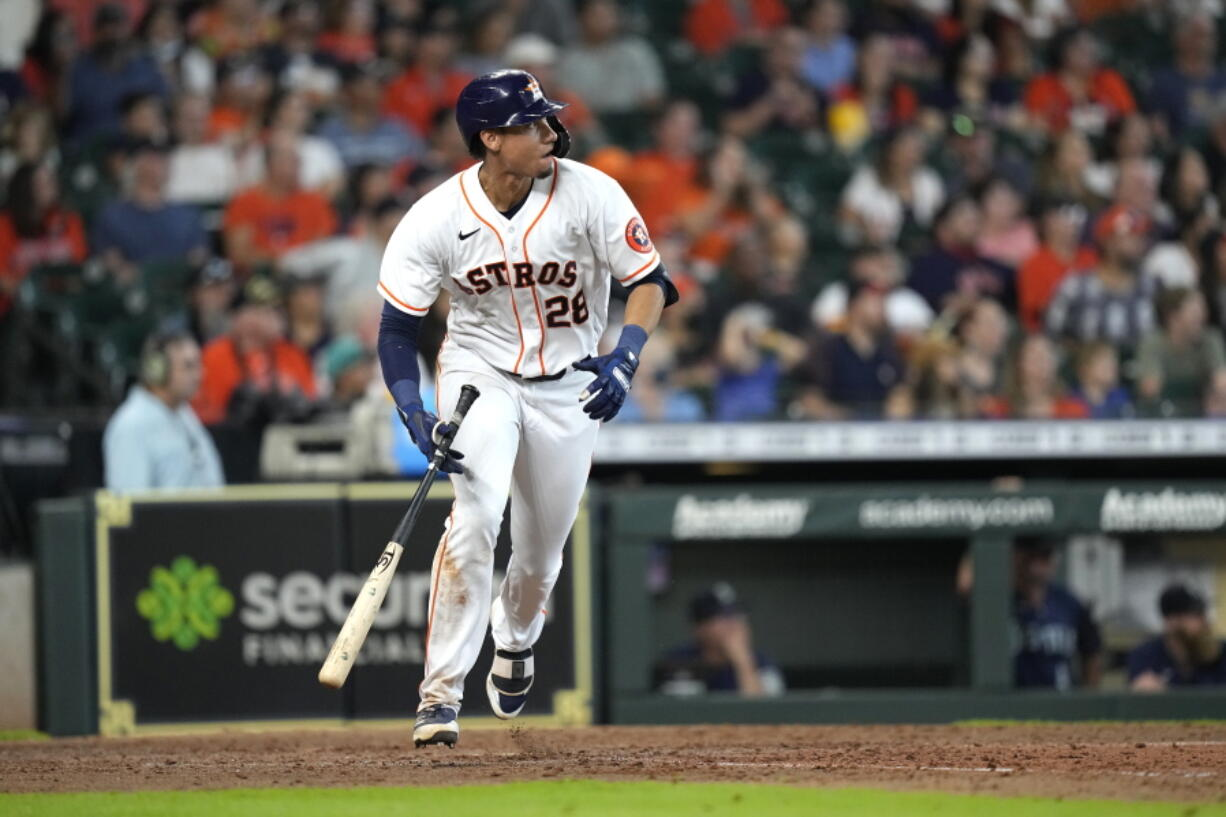 Houston Astros' Taylor Jones watches his two-run triple against the Seattle Mariners during the sixth inning of a baseball game Saturday, Aug. 21, 2021, in Houston. (AP Photo/David J.