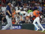 Houston Astros' Yordan Alvarez (44) runs the bases after hitting a two-run home run off Seattle Mariners starting pitcher Yusei Kikuchi, left, during the third inning of a baseball game Friday, Aug. 20, 2021, in Houston. (AP Photo/David J.