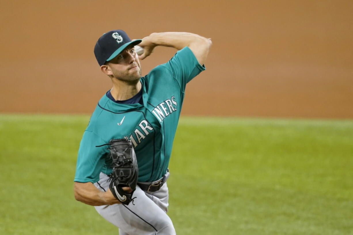 Seattle Mariners starting pitcher Tyler Anderson throws to a Texas Rangers batter during the first inning of a baseball game in Arlington, Texas, Tuesday, Aug. 17, 2021.