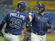 The Rays' Mike Zunino, right, celebrates with Brett Phillips after his solo home run off Seattle's Drew Steckenrider.