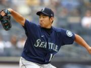 Seattle Mariners starting pitcher Yusei Kikuchi (18) throws against the New York Yankees during the second inning of a baseball game Sunday, Aug. 8, 2021, in New York. (AP Photo/Noah K.