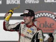 Ryan Blaney celebrates in Victory Lane after winning the NASCAR Cup Series auto race at Daytona International Speedway, Saturday, Aug. 28, 2021, in Daytona Beach, Fla.