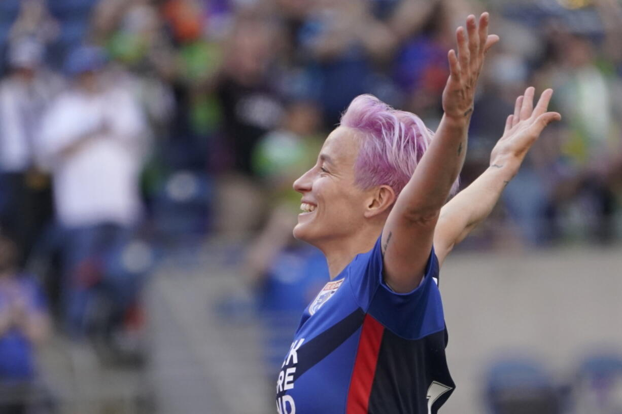 OL Reign forward Megan Rapinoe (15) celebrates after she scored a goal against the Portland Thorns during the first half of an NWSL soccer match, Sunday, Aug. 29, 2021, in Seattle. (AP Photo/Ted S.