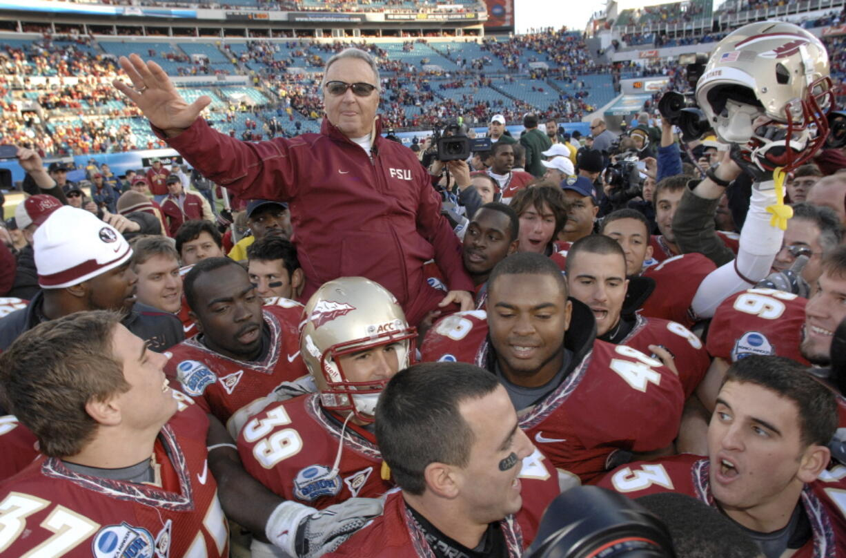 FILE - In this Jan. 1, 2010, file photo, Florida State head coach Bobby Bowden is carried on the shoulders of his players after their 33-21 win over West Virginia in the Gator Bowl NCAA college football game in Jacksonville, Fla. Bowden, the folksy Hall of Fame coach who built Florida State into an unprecedented college football dynasty, has died. He was 91. Bobby's son, Terry, confirmed to The Associated Press that his father died at home in Tallahassee, Fla., surrounded by family early Sunday, Aug. 8, 2021.