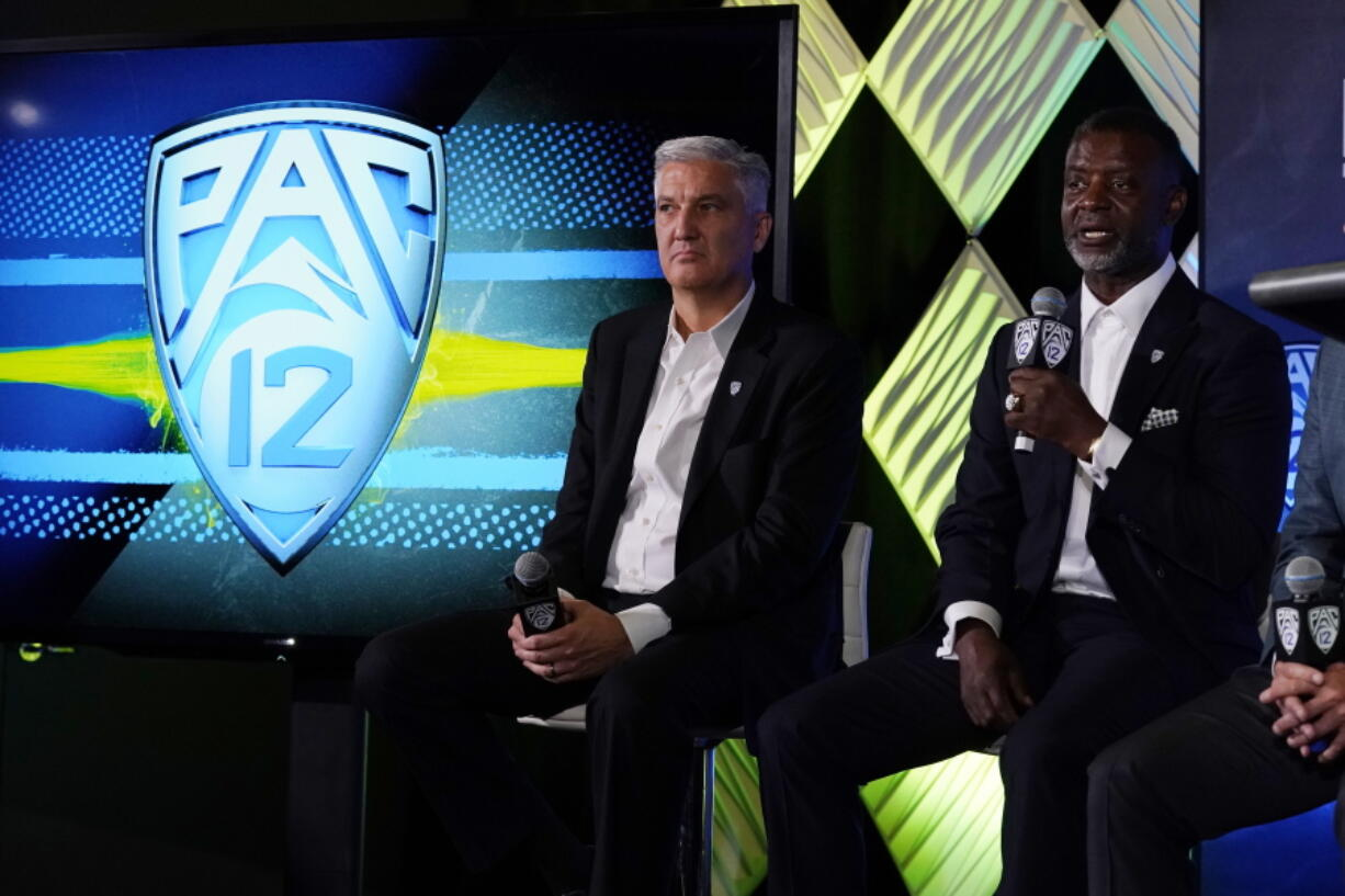 Pac-12 Commissioner George Kliavkoff, center, and Senior Associate Commissioner for Football Operations Merton Hanks field questions during the Pac-12 Conference NCAA college football Media Day Tuesday, July 27, 2021, in Los Angeles.