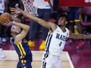 Portland Trail Blazers' Greg Brown III, right, fouls Indiana Pacers' Chris Duarte during the first half of an NBA summer league basketball game Thursday, Aug. 12, 2021, in Las Vegas.