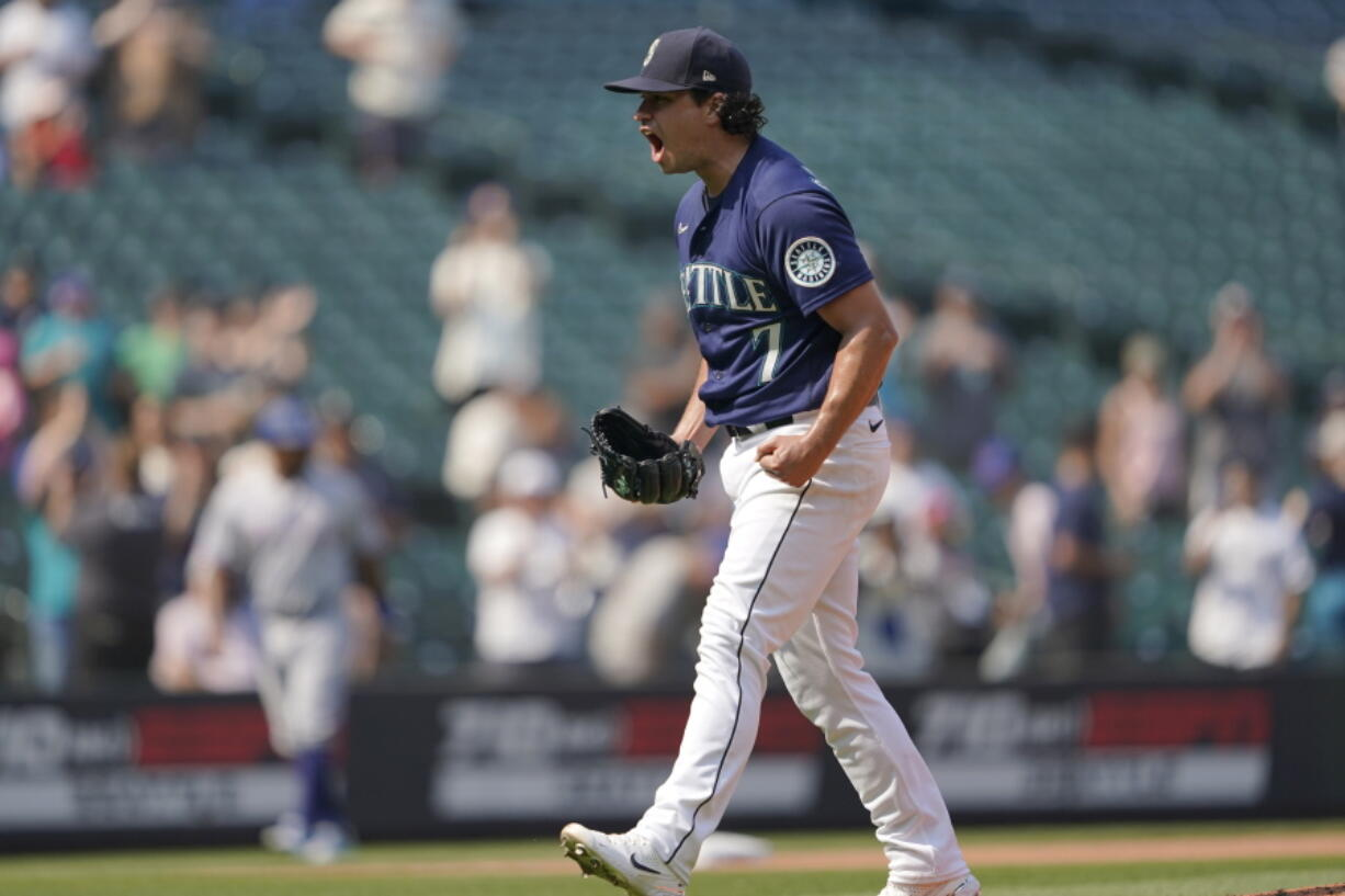 Seattle Mariners starting pitcher Marco Gonzales reacts after the final out the team's baseball game against the Texas Rangers, Thursday, Aug. 12, 2021, in Seattle. Gonzales pitched a two-hitter as the Mariners won 3-1. (AP Photo/Ted S.