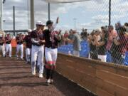 Ridgefield Raptors catcher Grant Heiser leads the team around the field to salute fans after Sunday's regular season home finale at Ridgefield Outdoor Recreation Complex.