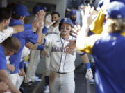 Seattle Mariners' Jarred Kelenic celebrates in the dugout after hitting a solo home run during the sixth inning of a baseball game against the Kansas City Royals, Sunday, Aug. 29, 2021, in Seattle.