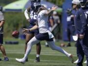 Seattle Seahawks punter Michael Dickson kicks during NFL football practice Thursday, July 29, 2021, in Renton, Wash. (AP Photo/Ted S.