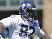 Seattle Seahawks defensive tackle Robert Nkemdiche reacts as he takes the field for NFL football practice Thursday, July 29, 2021, in Renton, Wash. (AP Photo/Ted S.