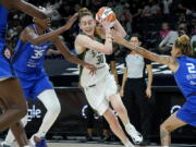Seattle Storm forward Breanna Stewart (30) drives as Connecticut Sun guard Natisha Hiedeman (2) and forward Jonquel Jones (35) defend during the first half of the Commissioner's Cup WNBA basketball game, Thursday, Aug. 12, 2021, in Phoenix.