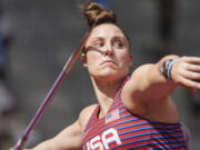 Kara Winger, of United States, competes in qualifications for the women's javelin throw at the 2020 Summer Olympics, Wednesday, Aug. 3, 2021, in Tokyo.
