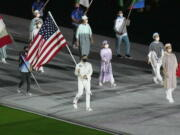 Kara Winger carries the flag of the United States of America during the closing ceremony of the 2020 Summer Olympics, Sunday in Tokyo, Japan.