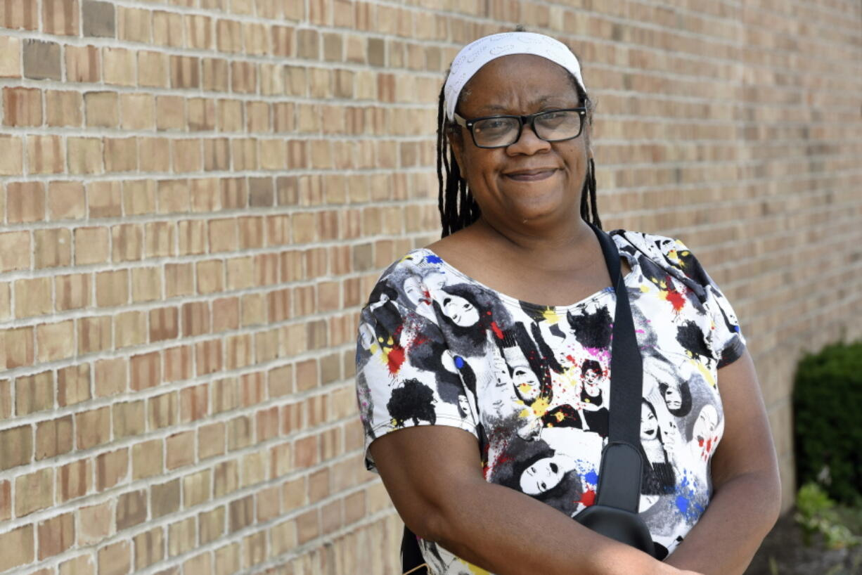 Regina Howard poses for a photo in Southfield, Mich., Friday, July 30, 2021. Lakeshore Legal Aid successfully helped Howard receive $24,550 in federal funds to pay for 15 months of rent.