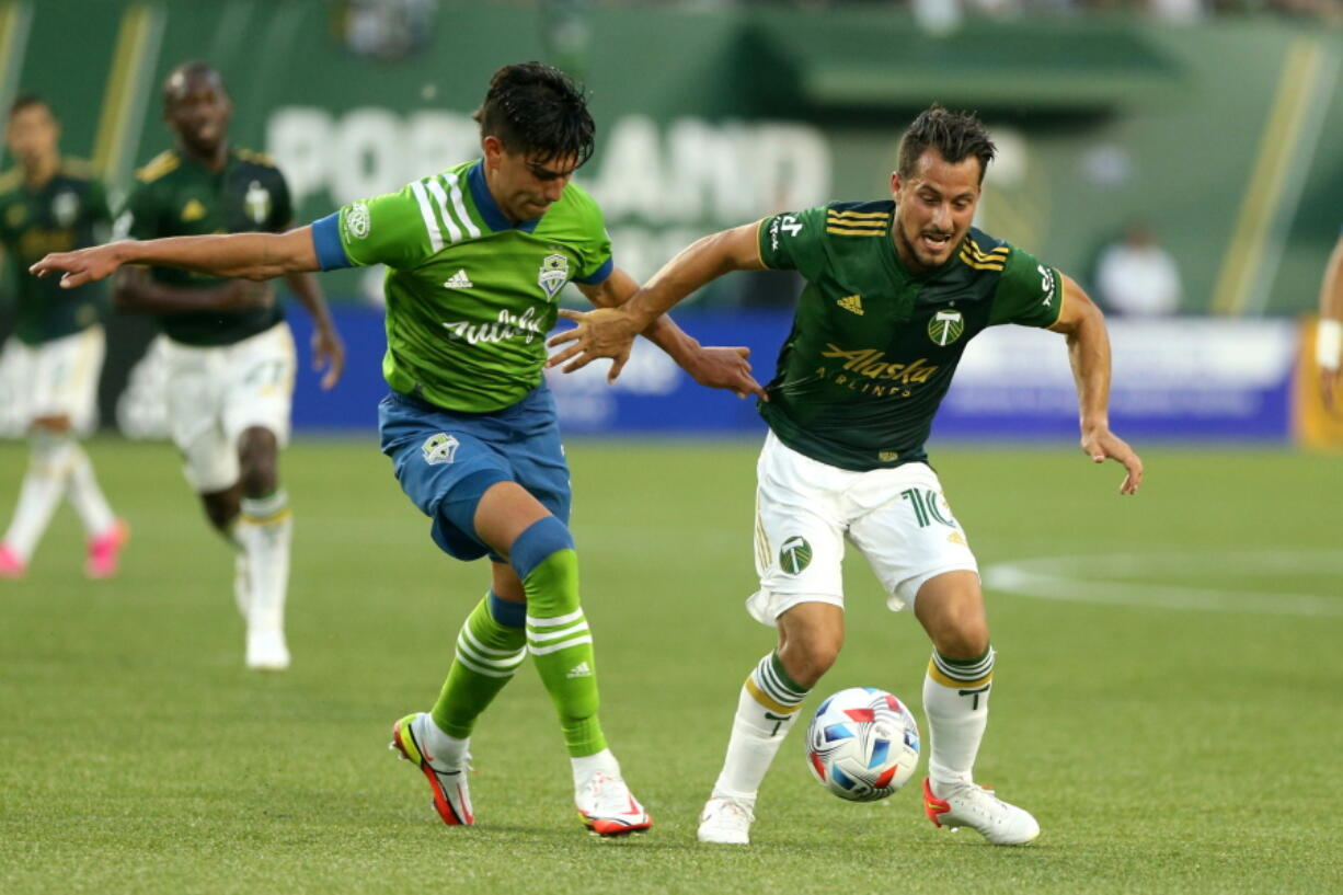 Timbers midfielder Sebastian Blanco, right, navigates around a Sounders defender during the Sounders' 6-2 win.