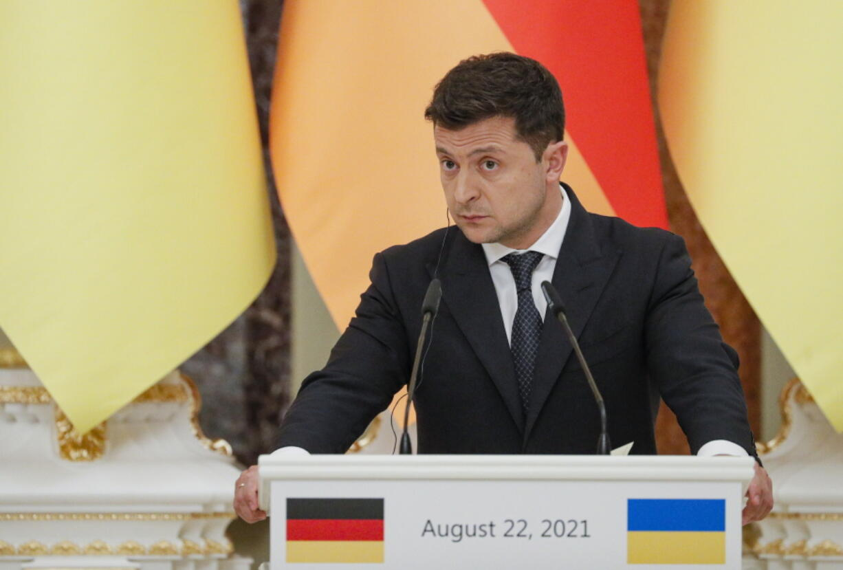 Ukrainian President Ukrainian President Volodymyr Zelenskyy attends a joint news conference with German Chancellor Angela Merkel following their talks at the Mariinsky palace in Kyiv, Ukraine, Sunday, Aug. 22, 2021. German Chancellor Angela Merkel arrived to Kyiv for a working visit to meet with top Ukrainian officials.