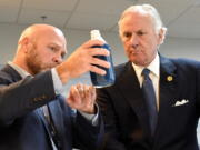 South Carolina Gov. Henry McMaster, right, listens as Foster Jordan of Charles River Labs, left, talks about the properties of horseshoe crab blood, which is a vital component in the contamination testing of injectable medicines - including the coronavirus vaccines - at Charles River Labs on Friday, Aug. 6, 2021, in Charleston, S.C. McMaster says the South Carolina company that bleeds horseshoe crabs for a component crucial to contamination testing of injectable medications is vital to development of a domestic medical supply chain.