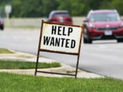 A help wanted sign is displayed at a gas station in Mount Prospect, Ill., Tuesday, July 27, 2021. (AP Photo/Nam Y.