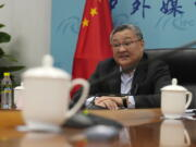 Fu Cong, a Foreign Ministry director general, speaks at a briefing for foreign journalists at the Foreign Ministry in Beijing, China, Wednesday, Aug. 25, 2021. China went on the offensive Wednesday ahead of the release of a U.S. intelligence report on the origins of the coronavirus, bringing out the senior official to accuse the United States of politicizing the issue by seeking to blame China.
