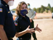 FILE - In this June 28, 2021, file photo, Oregon Gov. Kate Brown visits the Bly Fire Camp on the southern edge of the Bootleg Fire, in Klamath County, Ore. People in Oregon, regardless of vaccination status, will be once again be required wear masks in most public outdoor settings, including large outdoor events where physical distancing is not possible, beginning Friday, Aug. 27, 2021.