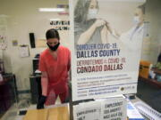 A Dallas County Health and Human Services nurse completes paperwork after administering a Pfizer COVID-19 vaccine at a county run vaccination site in Dallas, Thursday, Aug. 26, 2021.