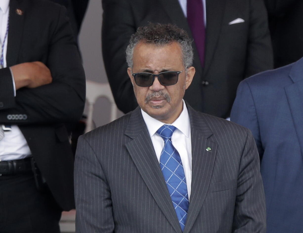 FILE - In this file photo dated Tuesday, July 14, 2020, Director General of the World Health Organization, Tedros Adhanom Ghebreyesus, attends the Bastille Day military parade, in Paris.  The head of the World Health Organization has appealed Wednesday Aug. 4, 2021, for a moratorium on administering booster shots of COVID-19 vaccines, to ensure doses are available in countries where few people have yet received their first shots.