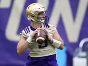 FILE - Washington Huskies quarterback Dylan Morris looks to pass during NCAA college football practice in Seattle, in this Friday, Aug. 6, 2021, file photo. Washington begins the 2021 season as one of the favorites in the Pac-12 North Division, while also trying to erase the bad taste of how last year ended when a COVID-19 outbreak brought a sudden end to an already truncated schedule.