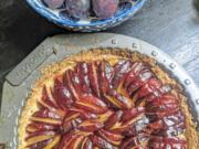 Italian prune plums are the start of this tart built on a lemon shortbread crust.