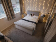 Also known as fairy lights or twinkle lights, string lights are a good way to add coziness to a room.