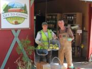 Andra and John Spencer show a recent harvest of fruit from their Washougal Get To-Gather retail farm stand.