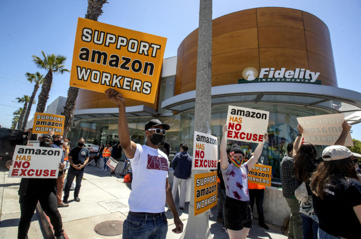 Ron Allen, foreground, left, a member of Art Directors Guild local 800, joins other supporters of Amazon workers protesting outside of Fidelity Investments in Santa Monica, California on May 24, 2021. Fidelity Investments is one of Amazon's largest shareholders. Activists want Amazon to be more accountable to workers, who too frequently get injured on the job.
